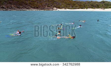 Yeppoon, Queensland, Australia - December 2019: Snorkelers Viewing The Underwater Coral Near Great K