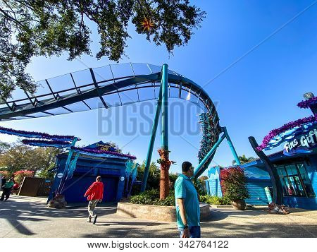 Orlando,fl/usa-12/25/19: People With Their Hands In The Air On The Mako Roller Coaster At Seaworld S