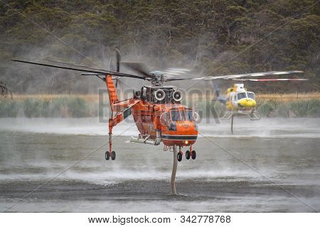 Bundoora, Australia - December 30, 2019: Erickson Air Crane Fire Bombing Helicopter (sikorsky S-64)