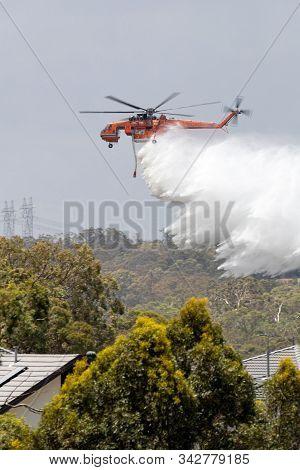 Bundoora, Australia - December 30, 2019: Erickson Air Crane Helicopter (sikorsky S-64) N243ac Droppi