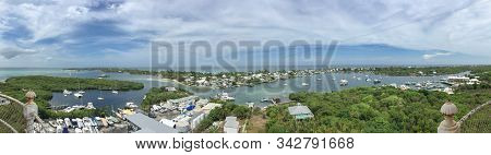 Panoramic Image Of Hope Town, Abaco, Bahamas With Boats And Water; Landscape Image