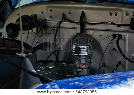 Old Classic Car Under Hood, View Of Chromed Carburetor And Tubes, Wires, Pipes, Mechanical And Elect
