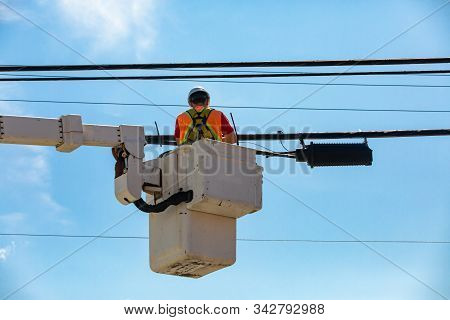 A Low Angled Shot Of A Man At Work In A Mobile Elevating Work Platform, Mewp Or Cherry Picker, Repai
