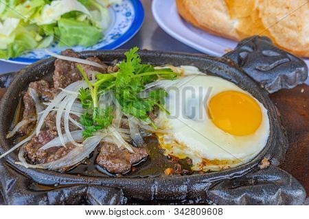 Plate Of Tasty Sizzling Beef Slices And Fried Egg- Teppanyaki