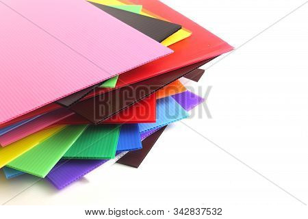 Group Of Colorful Corrugated Plastic Sheets On White