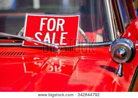 For Sale, Red Sign On Classic Antique American Bright Red Car Hood And Chrome Parts Close Up, During