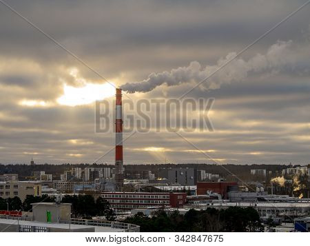 Stock Photo - Big Industrial Red And White Pipe With Smoke Going Outside. Toxic Smoke Pollutes The A