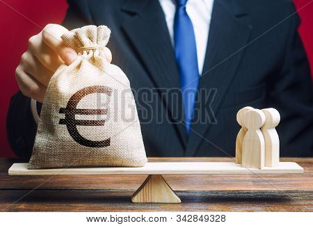 European Euro Eur Symbol On Money Bag And People On Scales. Concept Attracting Investment, Business