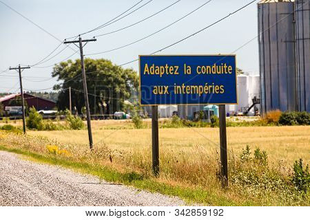 French Information Road Sign, Adapt The Driving To The Weather., On The Rural Country Roadside, With