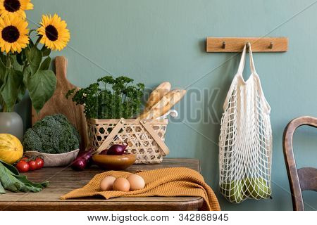 Vintage Kitchen Interior With Wooden Table And Kitchen Accessories. Minimalistic Concept Of Kitchen