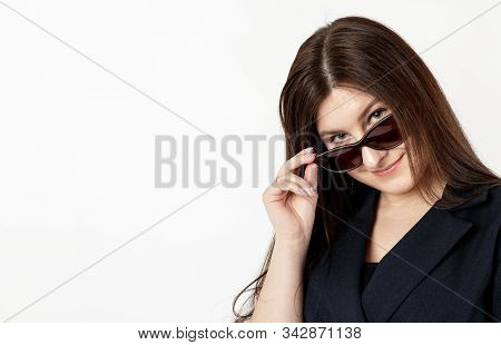 Young Woman In Sunglasses.