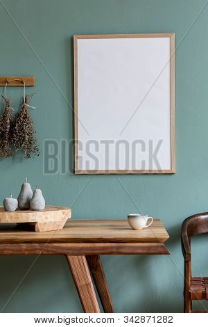 Stylish Scandinavian Dining Room Interior With Mock Up Poster Frame, Wooden Table, Chair And Elegant