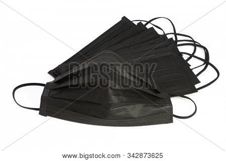 Black Activated Charcoal Face Mask On White Background