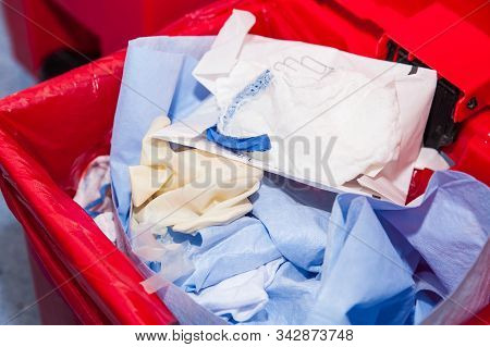 Biological Risk Waste Disposed Of In The Red Trash Bag At A Operating Room In A Hospital