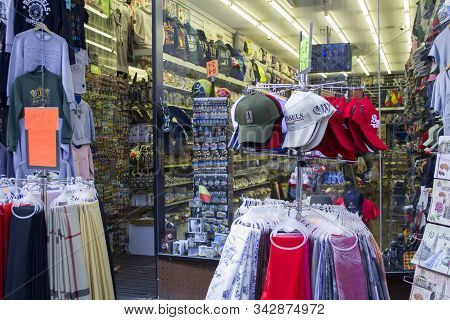 Brussels, Belgium - 6th June, 2019: A Wide Range Of Clothes And A Variety Of Souvenirs With Belgian