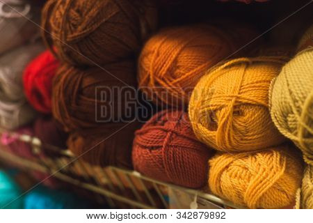Colored Skeins Of Wool On A Store Shelf. Woolen Skeins For Knitting All The Colors Of The Rainbow, B