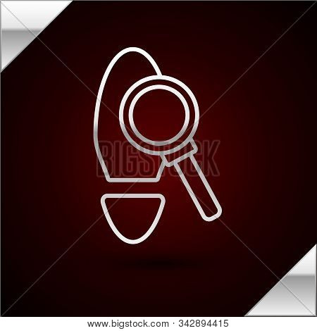Silver Line Magnifying Glass With Footsteps Icon Isolated On Dark Red Background. Detective Is Inves