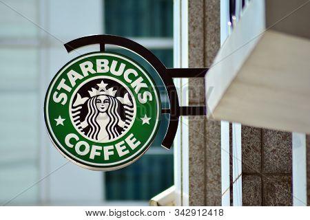 Warsaw, Poland. 23 April 2018. Sign Starbucks Coffee. Company Signboard Starbucks Coffee.