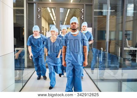Group of surgeons are running to an emergency in the emergency room or emergency room