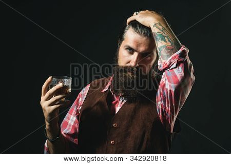 Bearded Businessman In Elegant Suit With Glass Of Whiskey. Sipping Whiskey. Bearded Handsome Man Hol