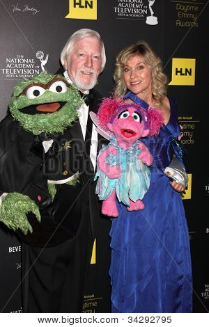 LOS ANGELES - JUN 23:  Caroll Spinney, left, and Leslie Carrara Rudolph arrive at the 2012 Daytime Emmy Awards at Beverly Hilton Hotel on June 23, 2012 in Beverly Hills, CA