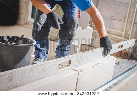 Mason Plastering The Concrete To Build Wall, Construction Under Building With Mason Plastering Concr