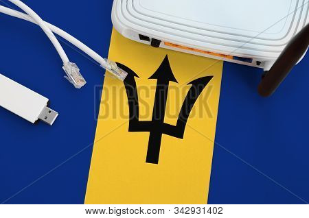 Barbados Flag Depicted On Table With Internet Rj45 Cable, Wireless Usb Wifi Adapter And Router. Inte