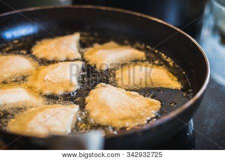 Fried Portuguese Or Brazilian Rissoles In A Frying Pan