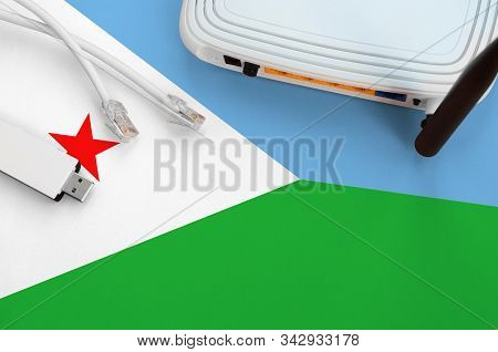 Djibouti Flag Depicted On Table With Internet Rj45 Cable, Wireless Usb Wifi Adapter And Router. Inte
