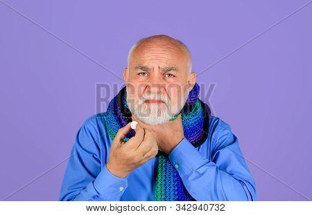 Sore Throat. Senior Man Taking Pharmaceutical Pills. Bearded Man With Sore Throat Taking Pills. Ill