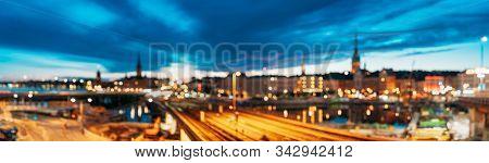 Stockholm, Sweden. Night Skyline Abstract Boke Bokeh Background. Design Backdrop. Panorama Panoramic