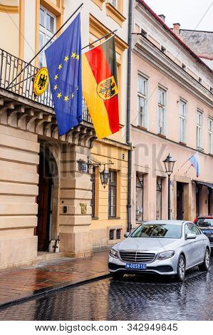Krakow, Poland - Apr 30, 2019: German And European Union Flags On Facade Of Consulate General Of The