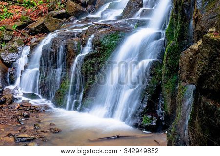 Waterfall Skakalo In The Forests Of Transcarpathia. Rapid Water Stream Runs Down The Huge Boulders.