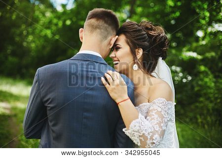 Happy Plus Size Model Woman With Stylish Wedding Hairstyle In A Fashionable Dress Laugh And Hug Hand