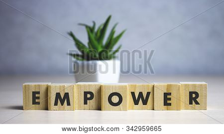 Empower Word Written On Wood Block. Empower Text On Table, Concept.