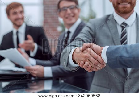 business people shaking hands during a business meeting .
