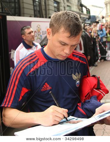 WARSAW; POLAND - JUNE 14: Marat Izmailov, Russian footballer who plays for Sporting Clube de Portugal is signing autographs; on June 14; 2012 in Warsaw; Poland.