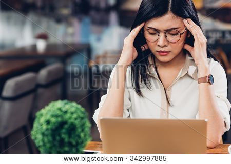 Lifestyle Freelance Working Woman And Laptop Computer He Headache Unhappy On Job In Coffee Cafe Shop