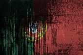 Portugal flag depicted in paint colors on old and dirty oil barrel wall closeup. Textured banner on rough background poster