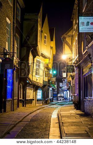 YORK, UK - MARCH 30: The Shambles is a former butchers' street in York with some buildings dating back from the fourteenth century . March 30, 2013 in York.