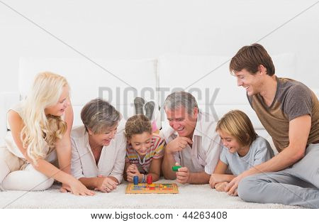 Family playing board games in sitting room