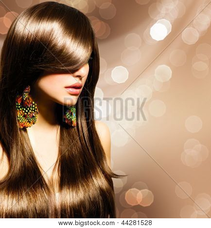 Hair. Beautiful Brunette Girl. Healthy Long Brown Hair. Beauty Model Woman. Hairstyle. Stylish Haircut. Fringe. Glossy Smooth Fashion Hair. Extensions