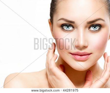 Beauty Portrait. Beautiful Spa Woman Touching her Face. Perfect Fresh Skin. Isolated on White Background. Pure Beauty Model. Youth and Skin Care Concept