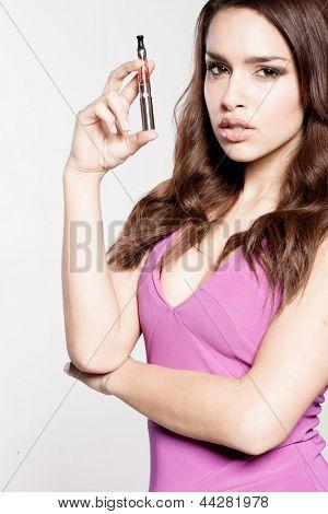 woman smoking e-cigarette wearing purple dres