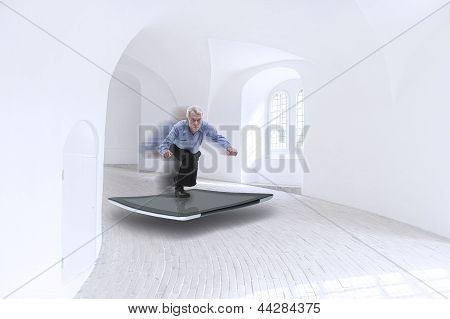 Senior Businessman Surfing On A Tablet
