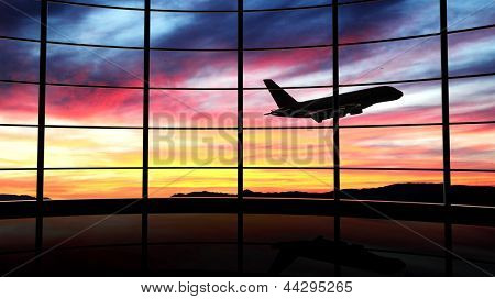 Airport window with airplane flying at sunset poster