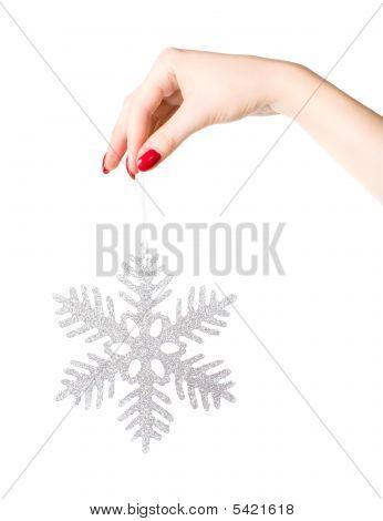 Woman Hand Holding Big Holiday Snowflake