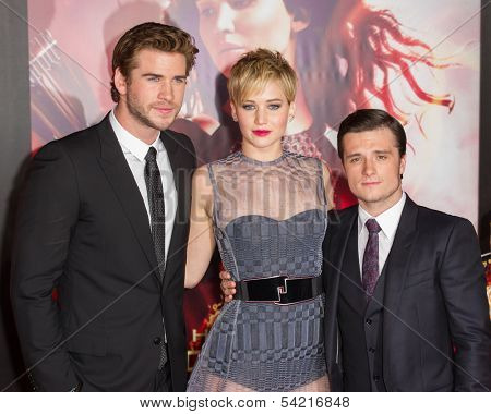 LOS ANGELES, CA - NOVEMBER 18: Actors Liam Hemsworth, Jennifer Lawrence and Josh Hutcherson attend the premiere of The Hunger Games: Catching Fire in Los Angeles, CA on November 18, 2013