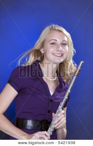 Teenage Flute Player Isolated On Blue