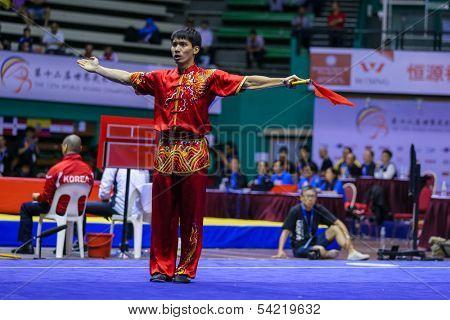 KUALA LUMPUR - NOV 03: Malaysia's Ng Say Yoke performs his fight routine in the Men's 'Daoshu' Event at the 12th World Wushu Championship on November 03, 2013 in Kuala Lumpur, Malaysia.